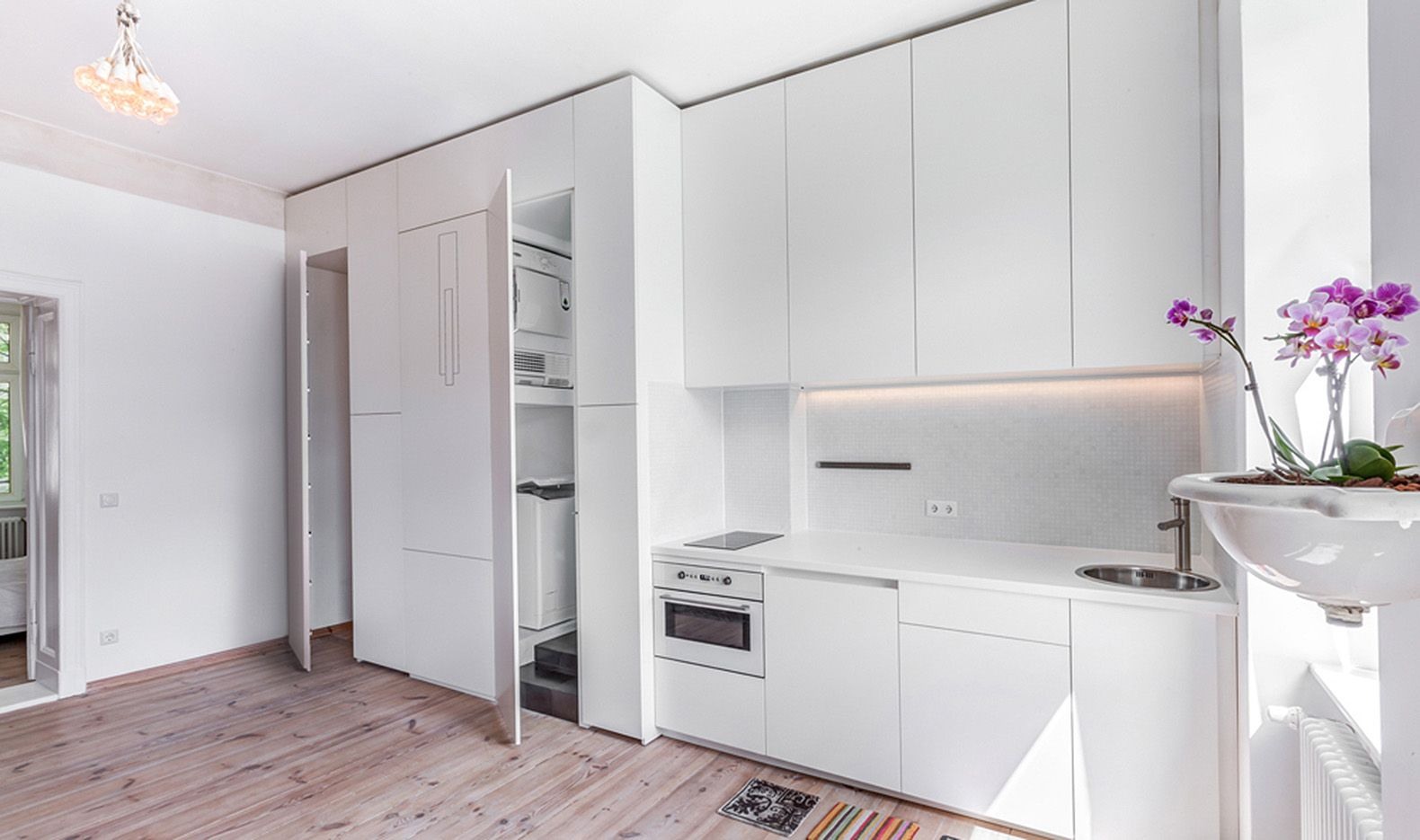 Furniture folds out of the walls in this tiny transforming apartment ...