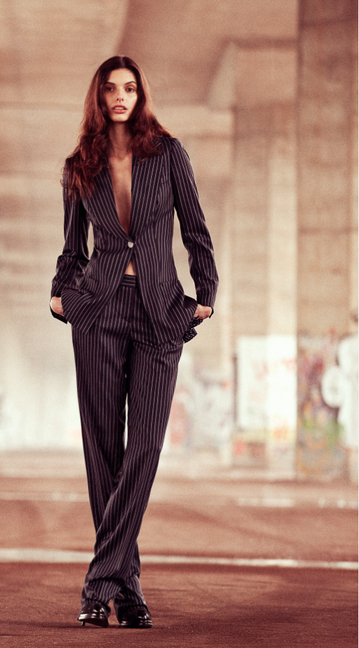 An absence of colour only serves to augment the allure, and a beautifully-cut tuxedo is the only accessory she needs.