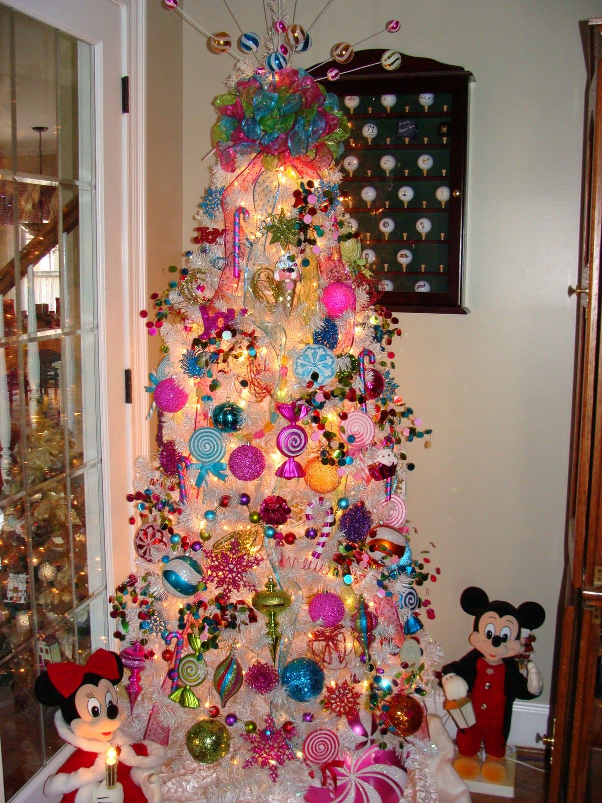 Christmas Candyland Theme with purple and red | This tree is decorated in a  {sweet