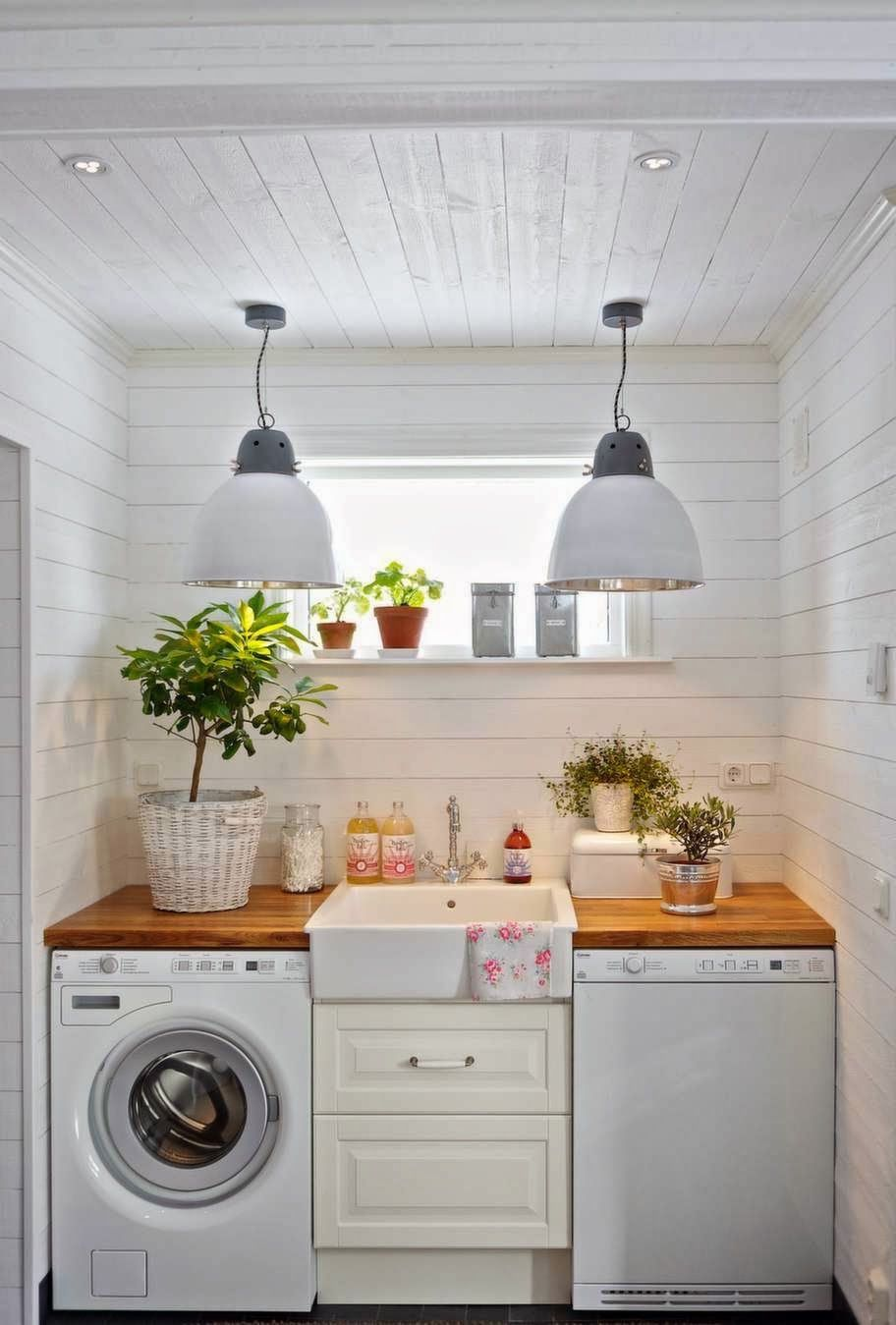 white shiplap small laundry room with center sink