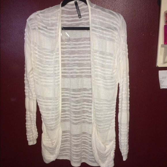 White cardigan with pockets Brand is Absolutely, bought at TJ.Maxx, never been worn! Absolutely Sweaters Cardigans