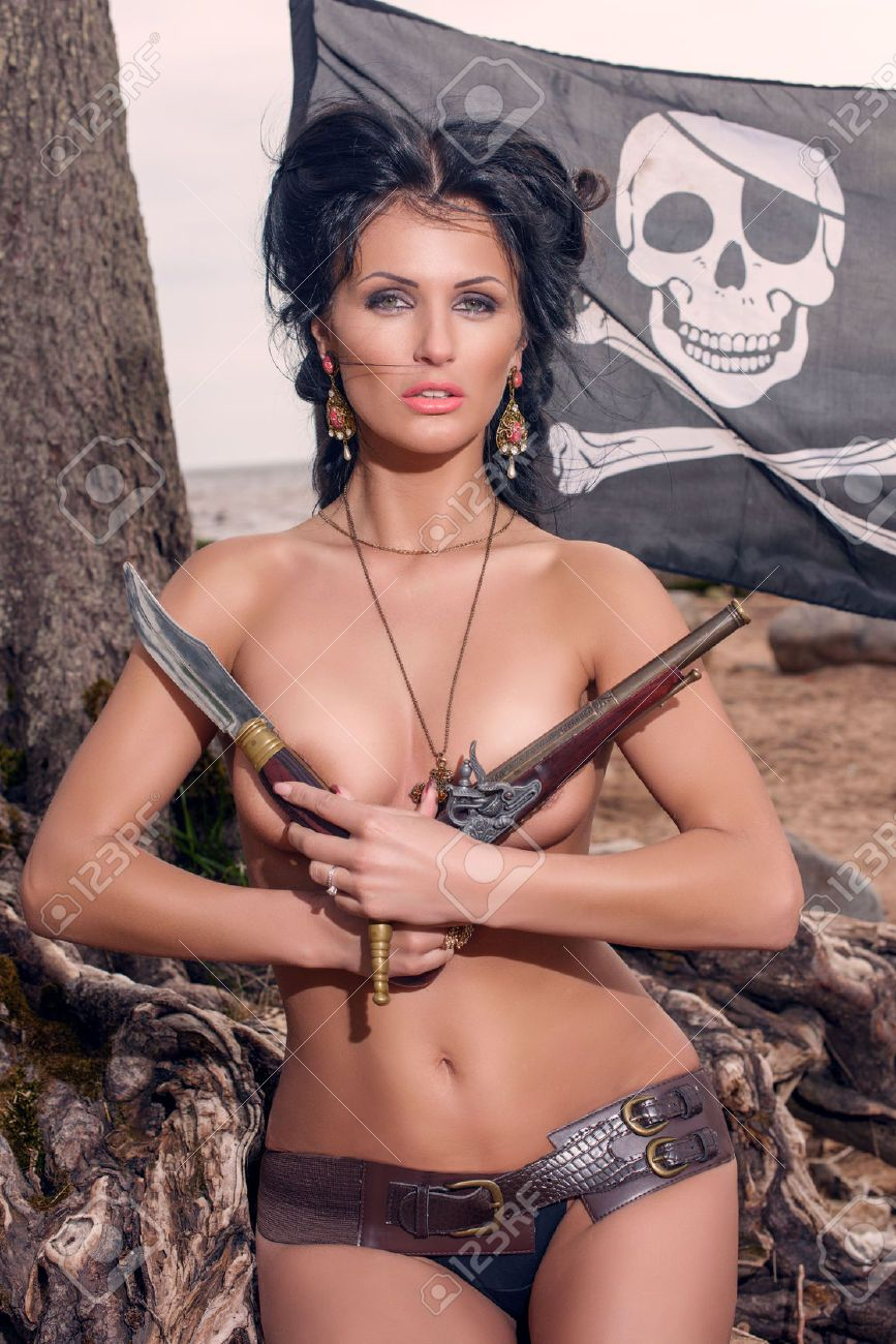 topless pirate woman covers her breasts with a classic pistols stock