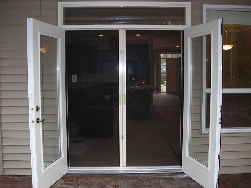 Holland screens outward opening french doors with for Double entry patio doors