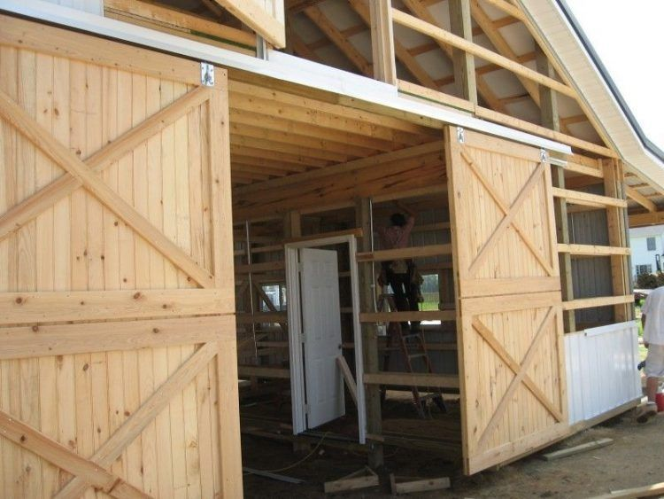 Large And Rustic Sliding Barn Door Design With Double Cross Accent