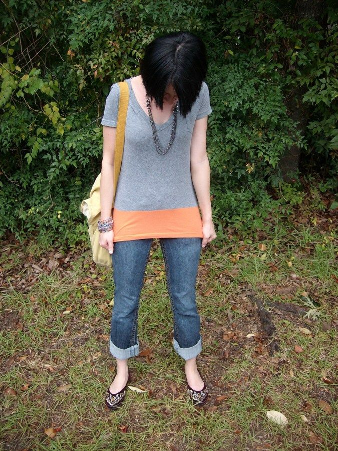 Too short tees on my long and hippy torso, a problem no more! This smart lady has a fix! Sew a piece of fabric from a throw -a - way tee to the bottom of offending too short tee and, hooray, long as you need tee.