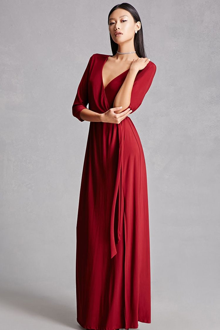 A knit maxi dress featuring a surplice front long sleeves a