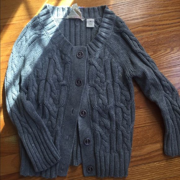 Cable knit cardigan Adorable cable knit cardigan. NWOT, never worn. Dark gray. Not as light as in the last pic, just wanted to show the texture. Cute oversized buttons. Flattering stretchy fit. Tagged size M, but I'd say more like a S or juniors M bp Sweaters Cardigans