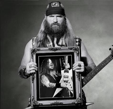 Zakk Wylde, from Black Label Society and Ozzy, holding a portrait of Dimebag Darrell