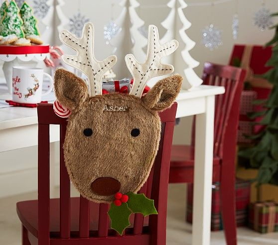 Set the table with a little holiday magic using Christmas dinnerware and table decorations from Pottery Barn Kids. & Reindeer Chairbacker | Pottery Barn Kids | christmas inspiration ...