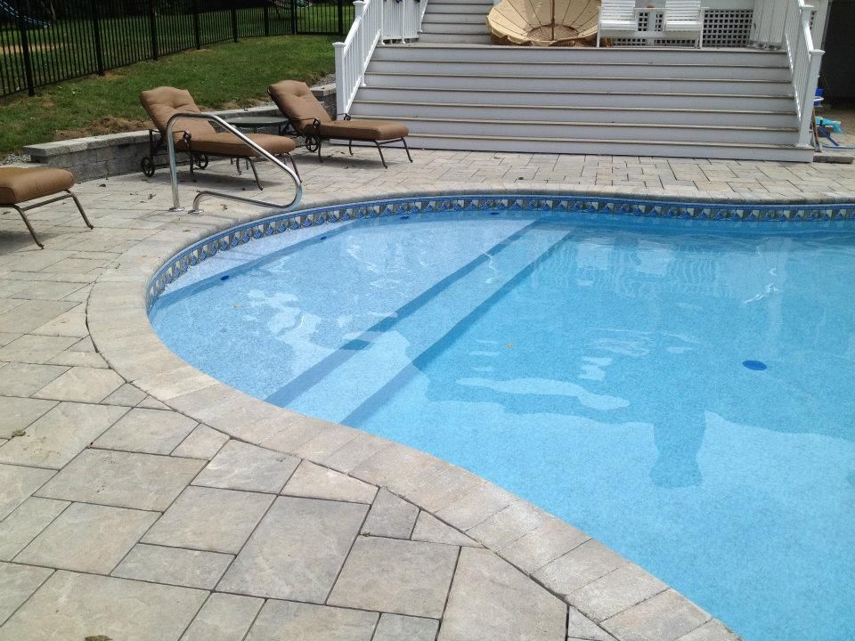 Vinyl liner pools with tanning ledge vinyl liner in for Pool design with tanning ledge