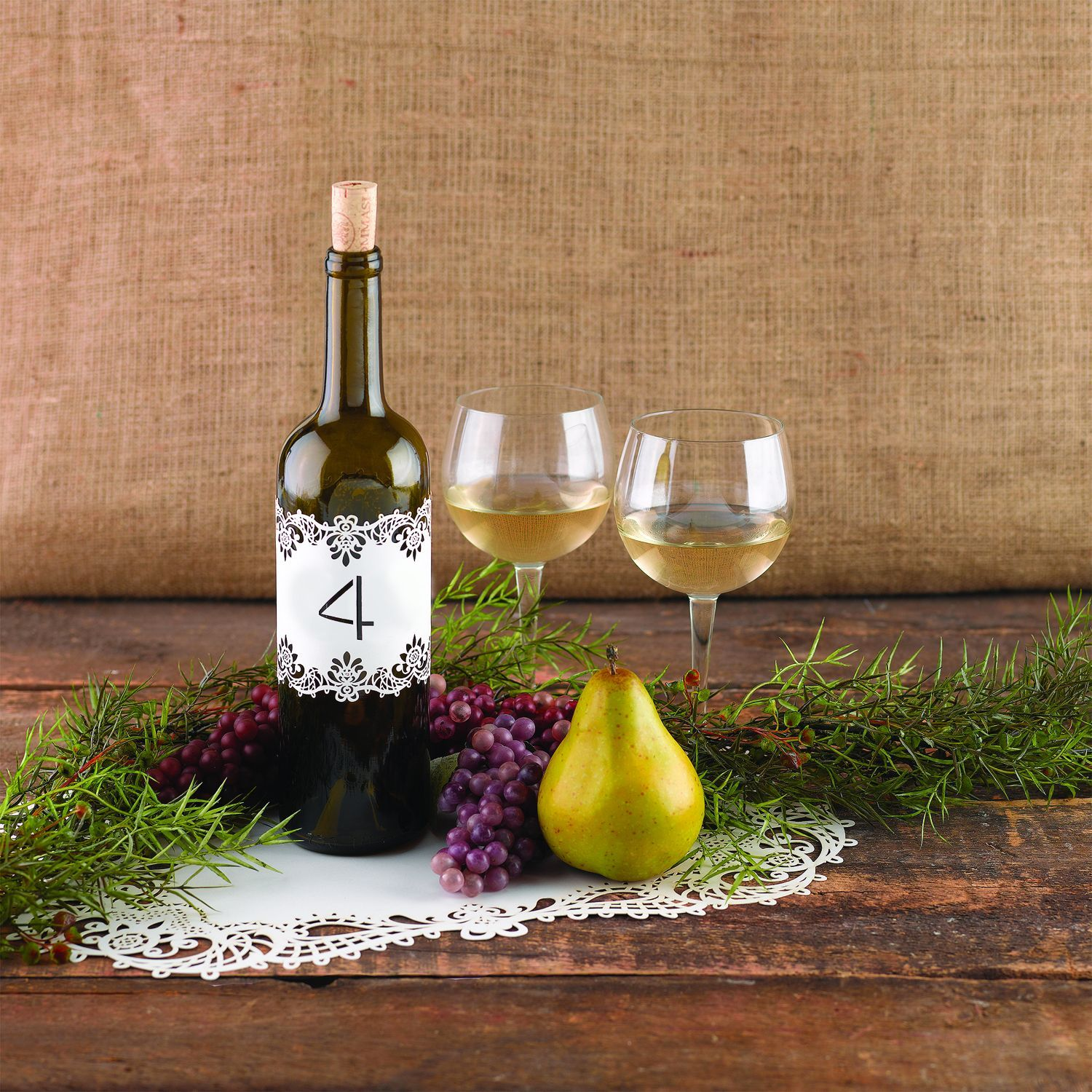 Add elegance to your centerpieces with these white decoration wraps, featuring the numbers 1-10. Clear seals are included to secure the wraps around candles, wine bottles and more without leaving a tacky line.