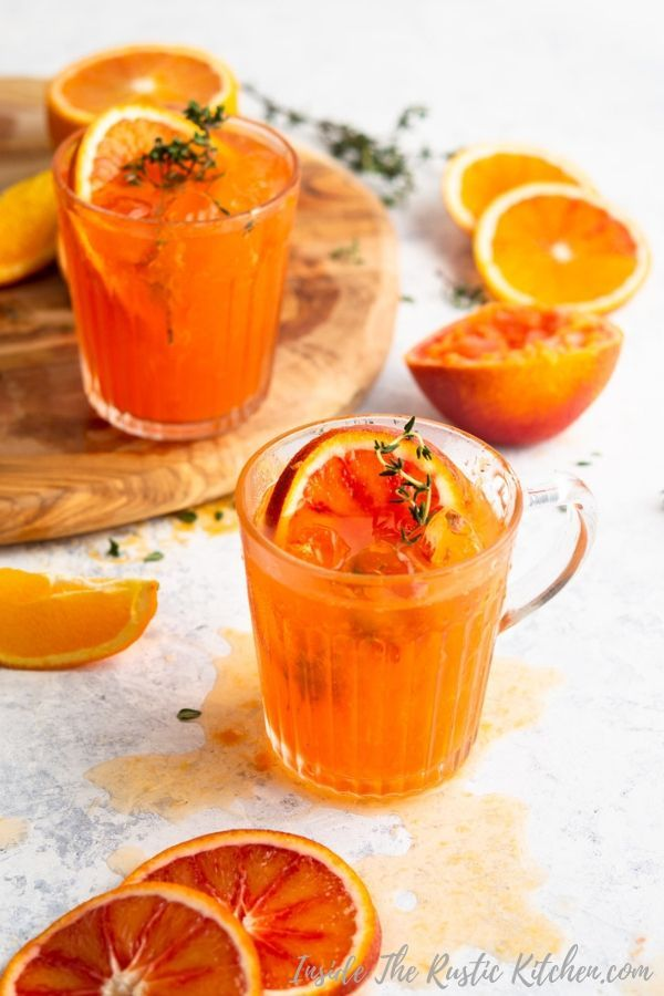 A delicious blood orange cocktail made with gin, Cointreau and prosecco. Super easy and full of juicy, fresh flavours. Garnish with a sprig of thyme. | Easy Cocktail Recipes | Brunch Cocktails | Orange Cocktail | #cocktail #orangecocktail #bloodorange