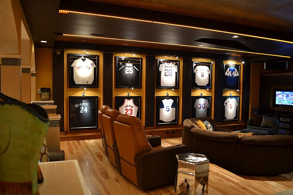 Man Cave Idea Display Uniforms Of Your Favorite Players And Watch The Big Game On Tv Sports Man Cave Man Cave Basement Man Cave Design