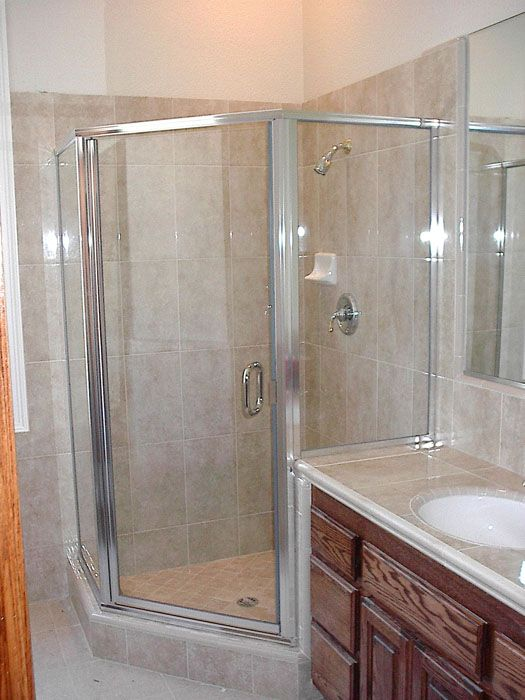 Glass Corner Shower In Kansas City Installed With Silver Frame By