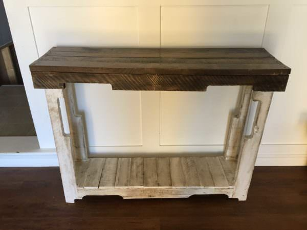 This rustic pallet sofa tableis a beautiful and functional addition to the room. It's made from only two pallets. Sofa Table Finish: The table top was stainedin adark walnut color. I painted the bottom portion with white paint and distressed…