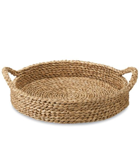 Sweeten up your moning with these artisanal finds. In this photo: A braided water hyacinth tray. It's as sturdy as it is pretty. (Onslow Tray, $39.95; crateandbarrel.com)