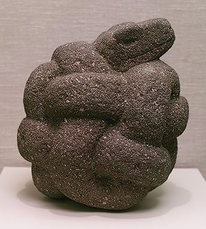 This is supposedly a statue of a coiled serpent from the Aztecs circa 16th century.  It really looks more like a fossilized pile of terds.