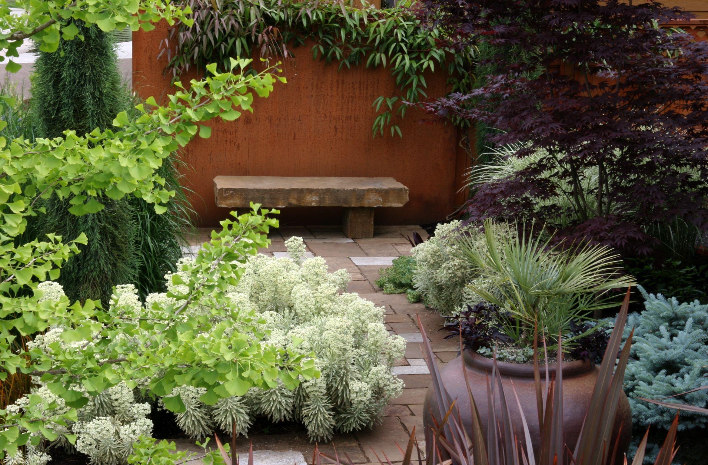 Home garden design flower  quite a lot going on with rust wall reliefMOSAIC GARDENS