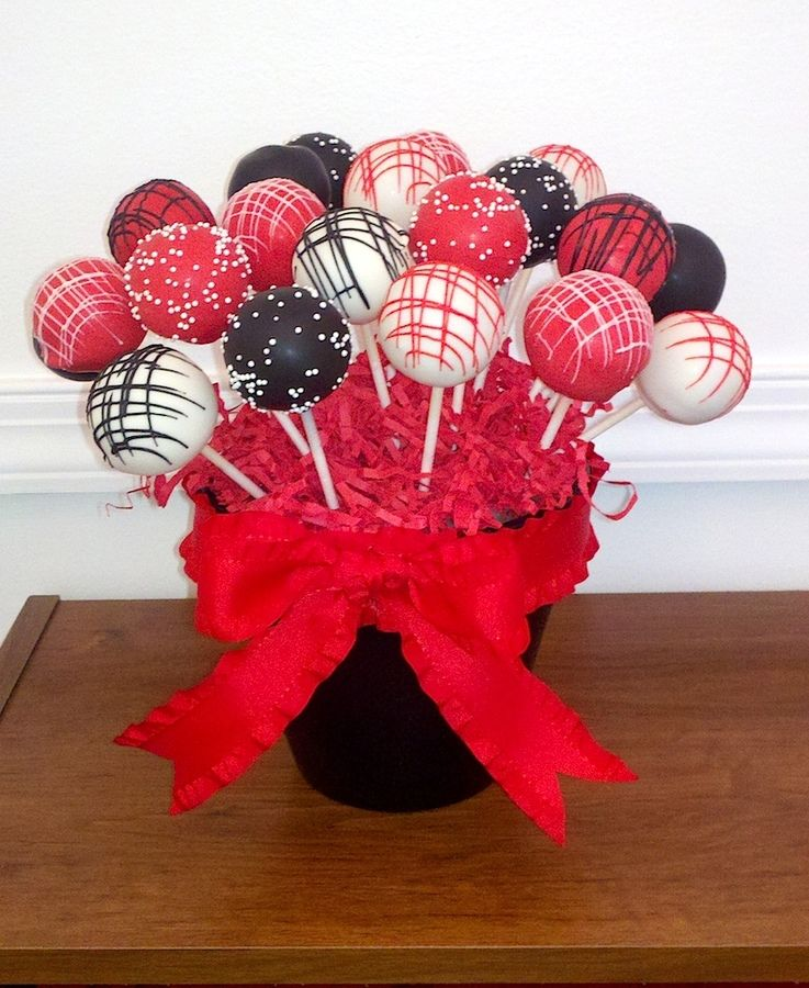 Cake pops colored and decorated in red, black, and white for a sweet 16's