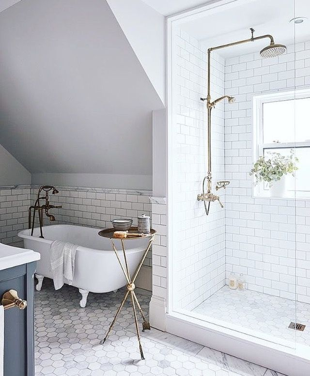 Mid century modern white bathroom with brass fixtures and floating ...