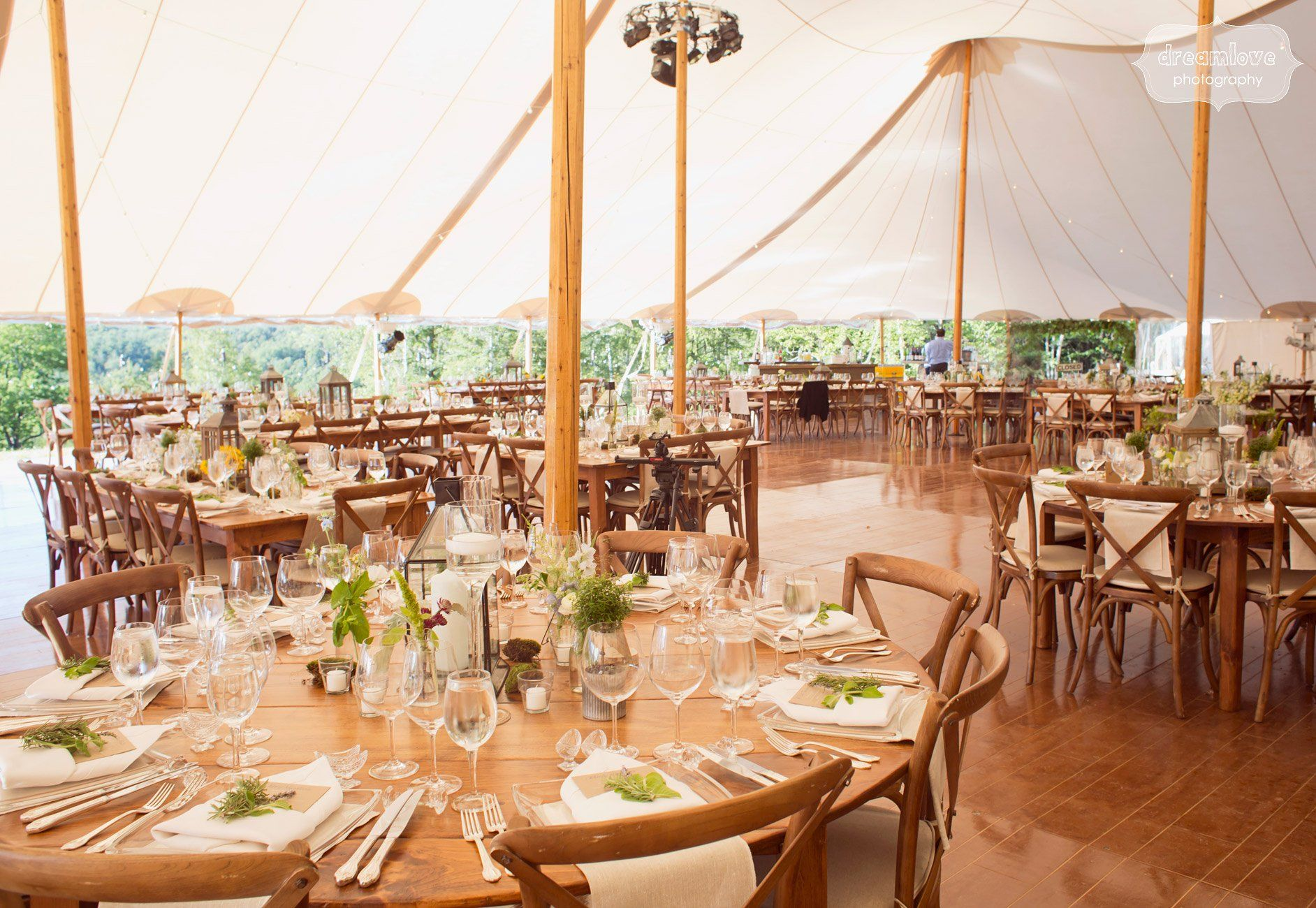 gorgeous sailcloth reception tent with several posts set up for a