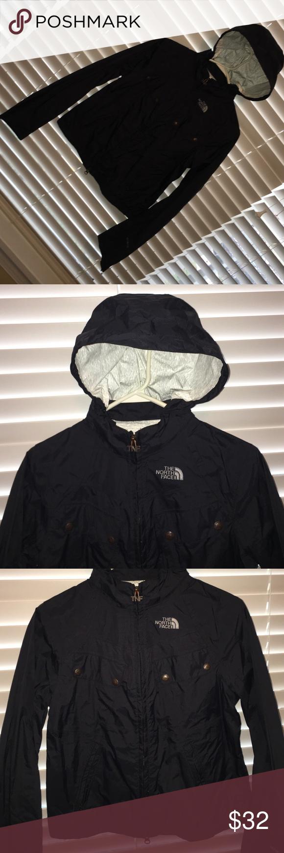 The North Face rain coat w/ detachable hood size S THe North Face Size S/P, Black, detachable hood, zipper pockets, button front pockets. Hip length North Face Jackets & Coats