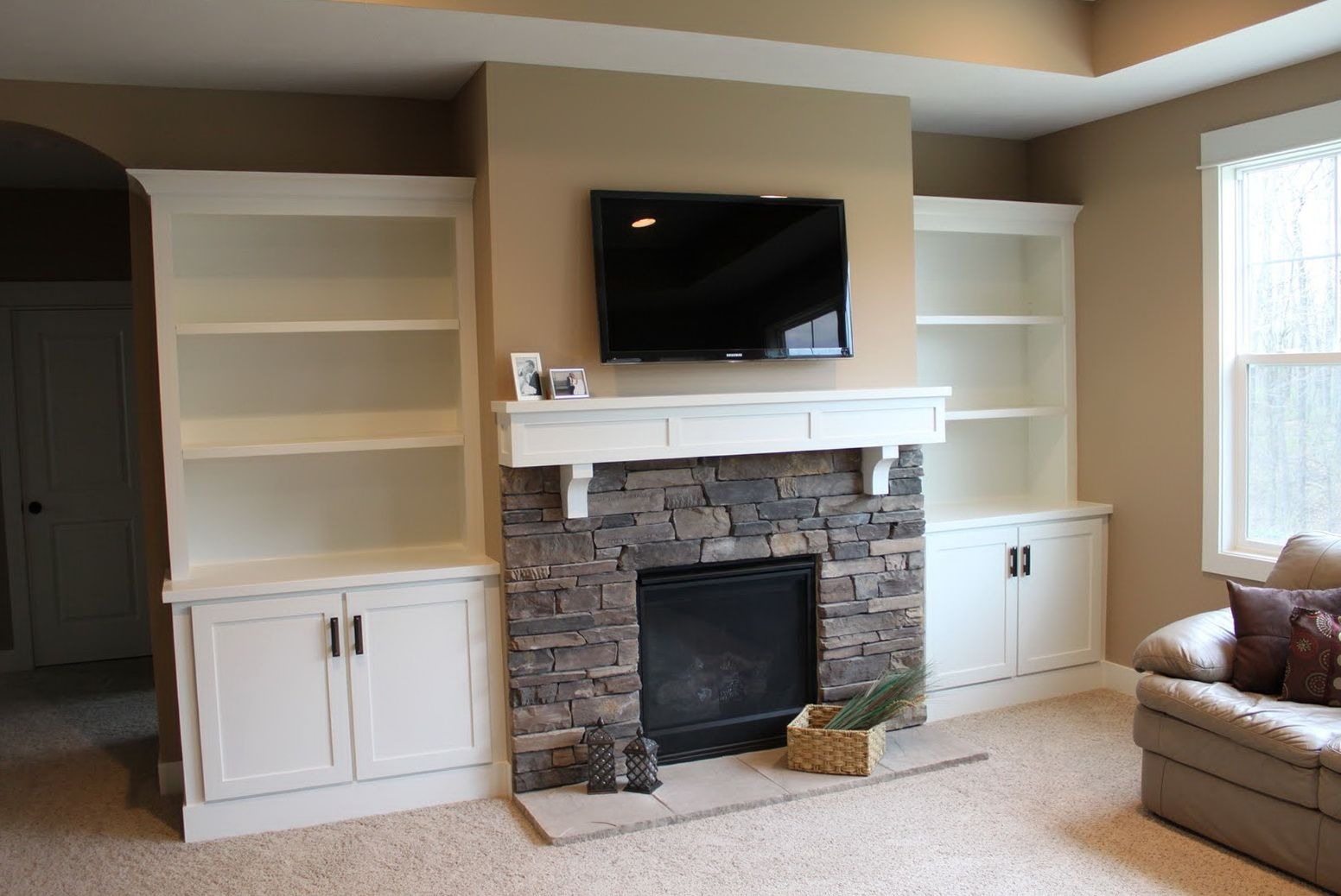 Wall To Wall Built In Entertainment Center With Fireplace