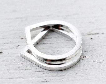 I love the contrast between the twisted bands mixed with shiny smooth plain ones together. Here are 10 solid silver rings in one bundle held together with a flat band/clip that runs around the rings – stamped with a lovely vintage leaf/feather and floral motif thats been oxidized to let the details pop. The rings are free to move around through the band. Please allow for a 4-6 working days lead time to fabricate your order before shipping…