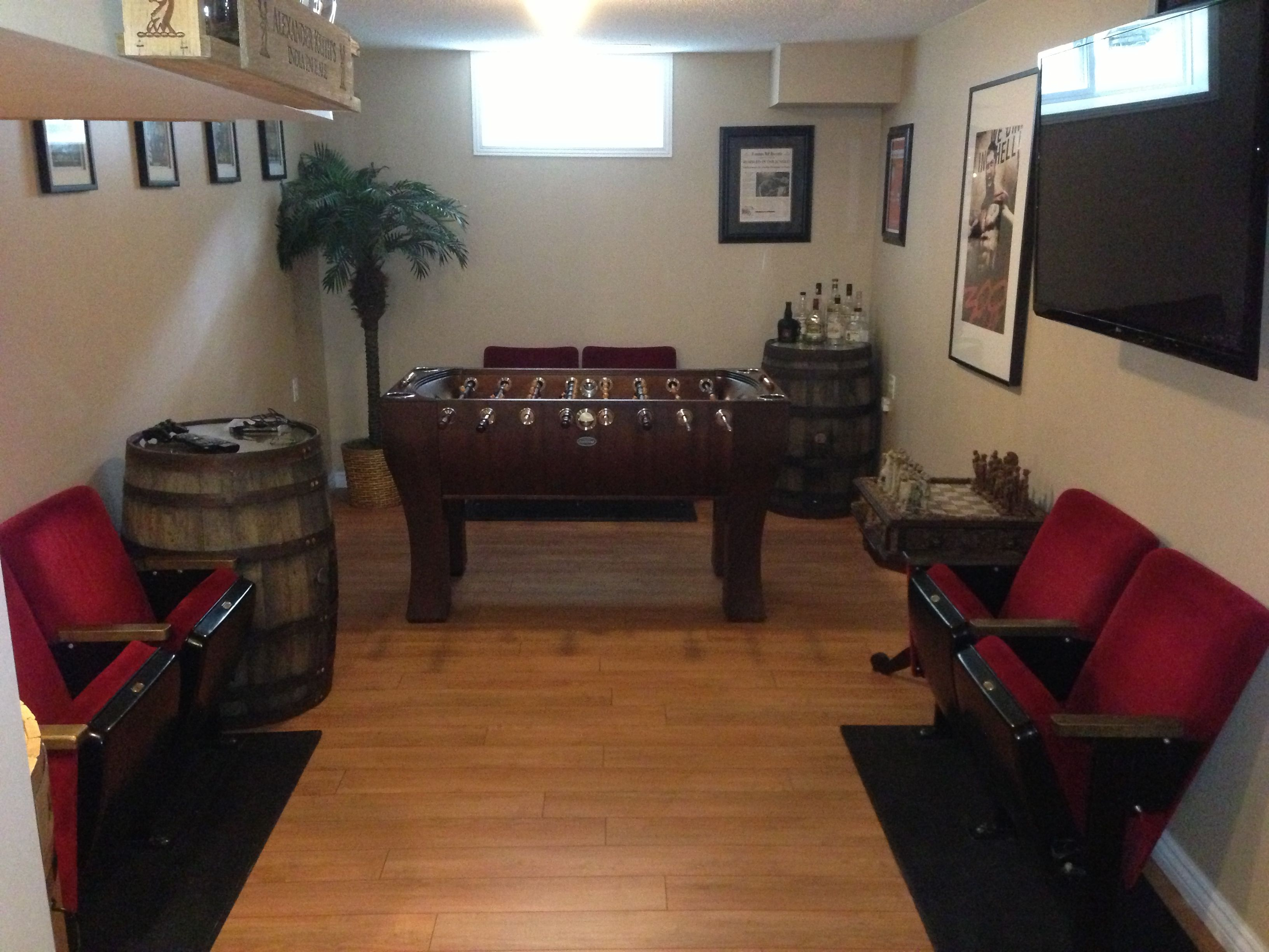 Small Man Cave Basement : Old whiskey barrels as side tables complete a small man cave