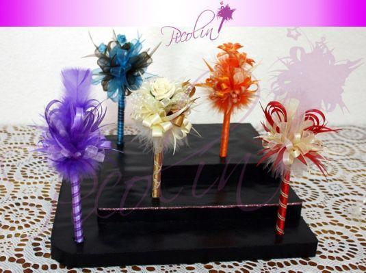 plumas decoradas para bautizo