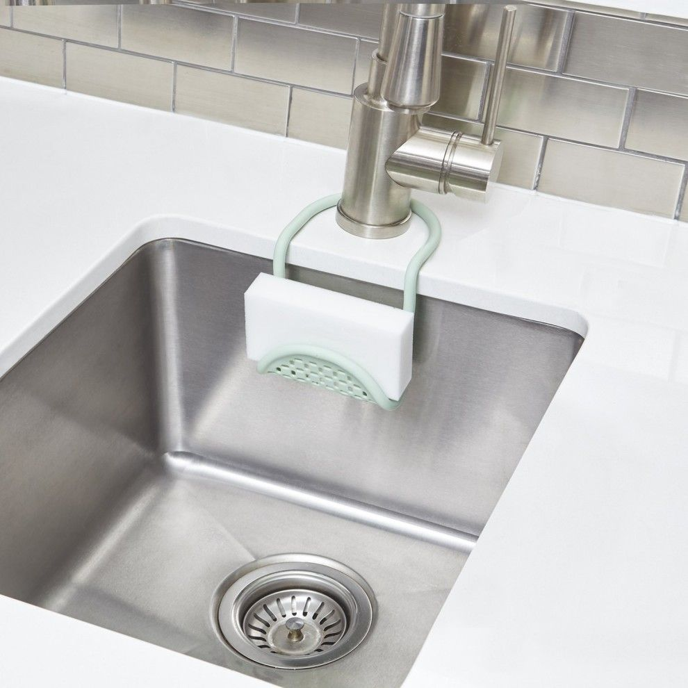 A Sponge Holding Caddy That Slips Right Around A Sink S Faucet