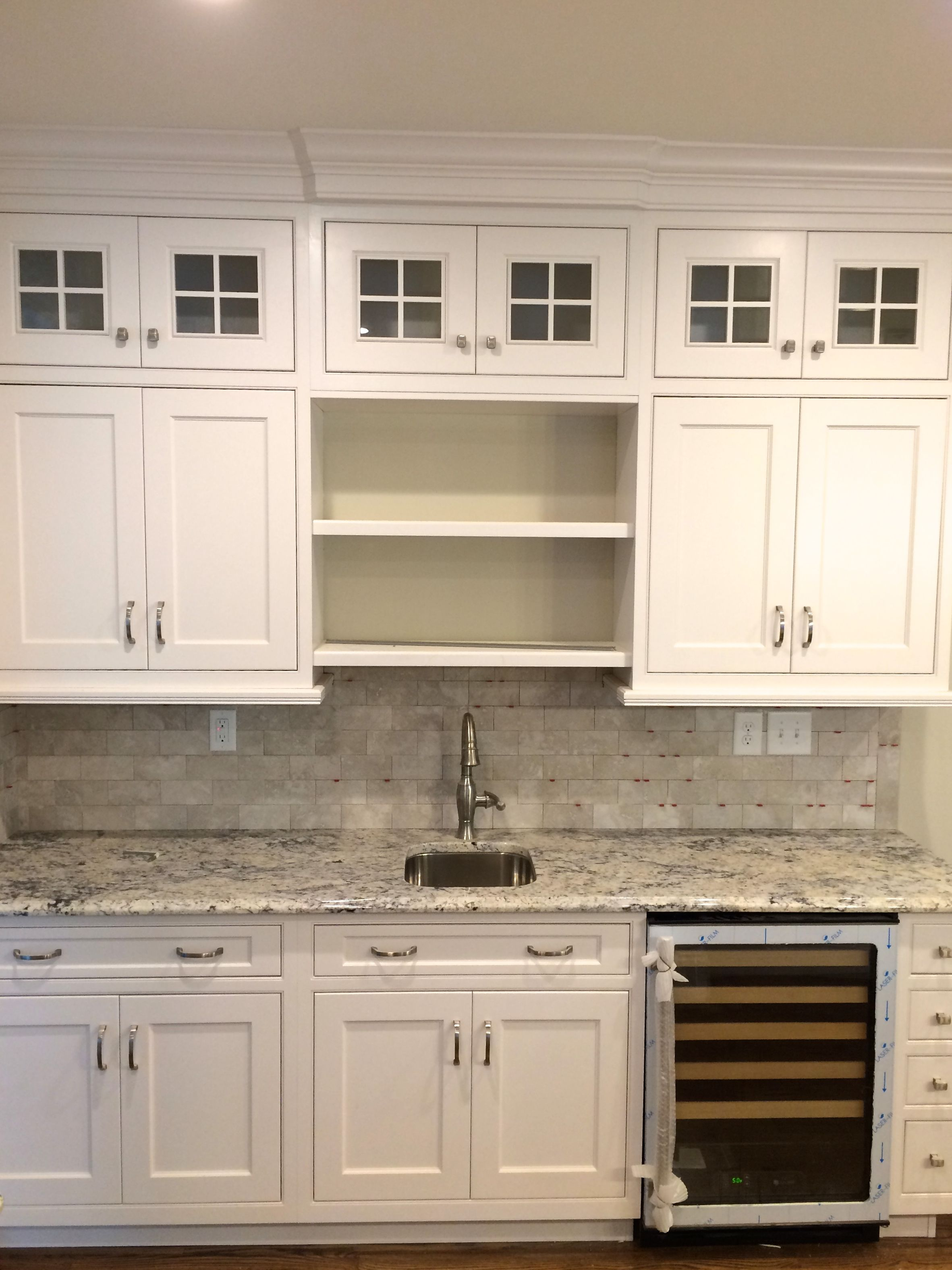 "Ice White"" Granite countertops with Dynasty Maple Pearl Cabinetry"