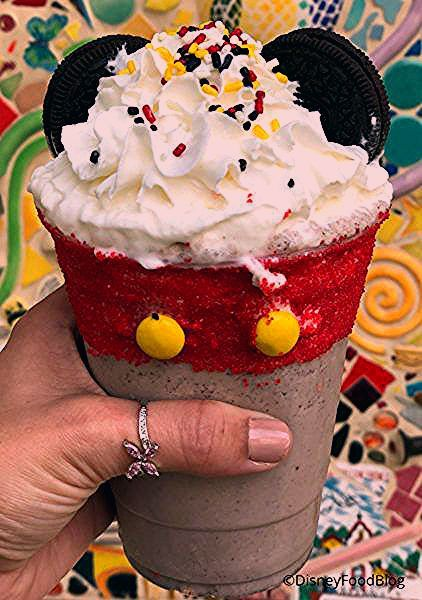 Photo of Disneyland Review: Mickey Apple Croissant Donut and Mickey Cookies and Cream Shake at Schmoozies!