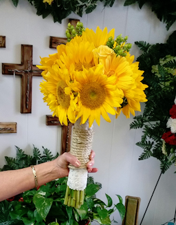 We love this beautiful bouquet of sunflowers wrapped with burlap twine by Holman Florist.  This is not only perfect for a friend, loved one, or a rustic wedding.  Click on the image to learn more about Fairview's florist, Holman Florist.  Photo credit: Holman Florist Facebook