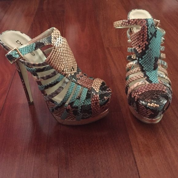 Bebe heels/sands Bebe sandals/heels gently used. Size 7, colorful snake print. only been worn once or twice. I don't have the original box anymore since I move around a lot I threw it away last year. bebe Shoes Heels