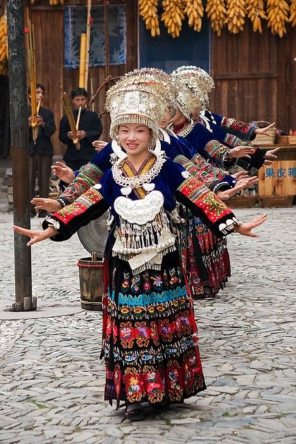 Girls performing traditional Miao dance  | China photo