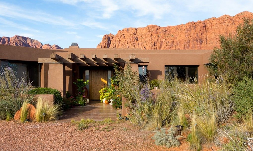 A Unique Community Of Modern Green Homes Hug The Desert Floor In