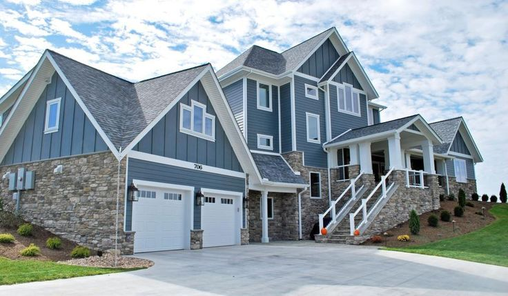 Contemporary Farmhouse With Stone Accents White Trimming Dusty Blue Exterior