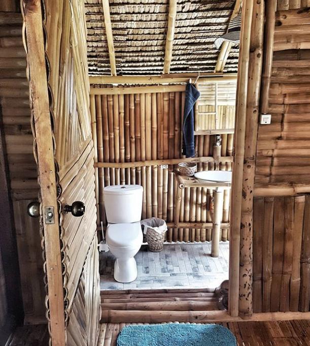 Nipa hut bathroom. | Bamboo house design, Wooden house ...