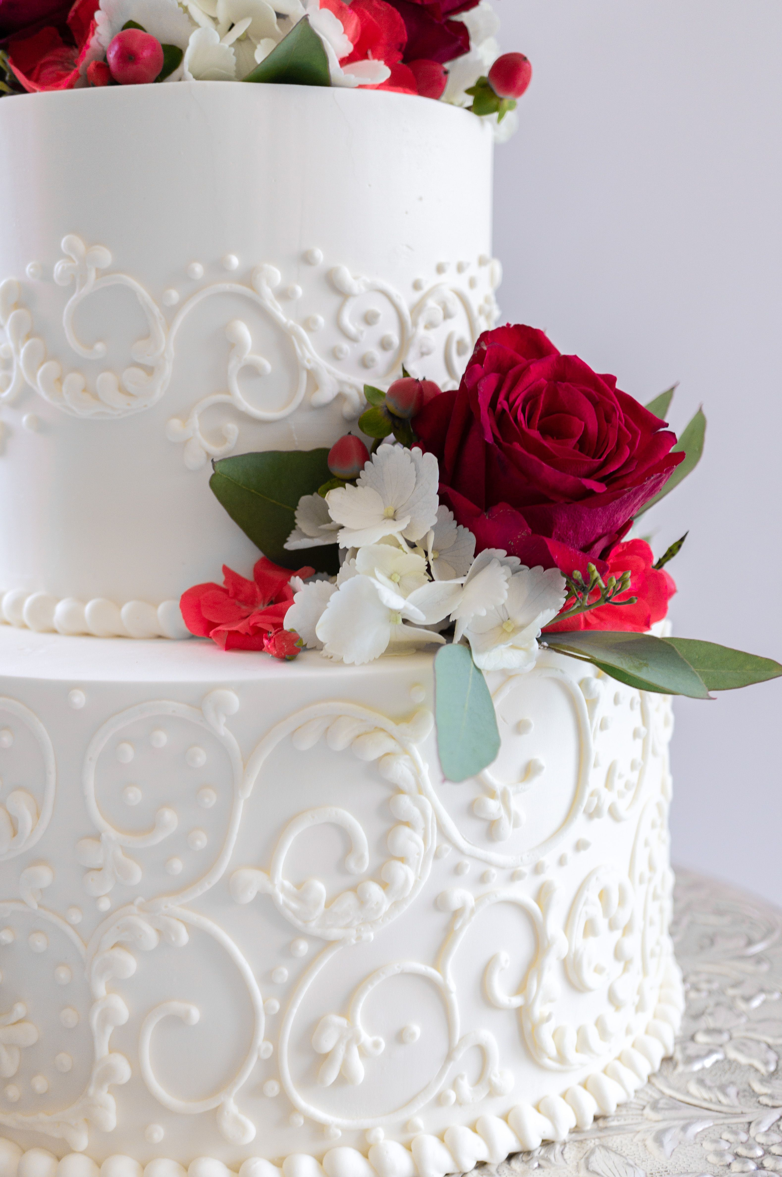 Two-tier wedding cake with piped buttercream filagree and classic ...