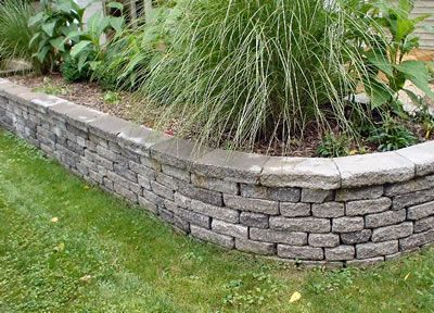 like this but i would need stone with more color not the mundane grey raised flower bedsraised garden