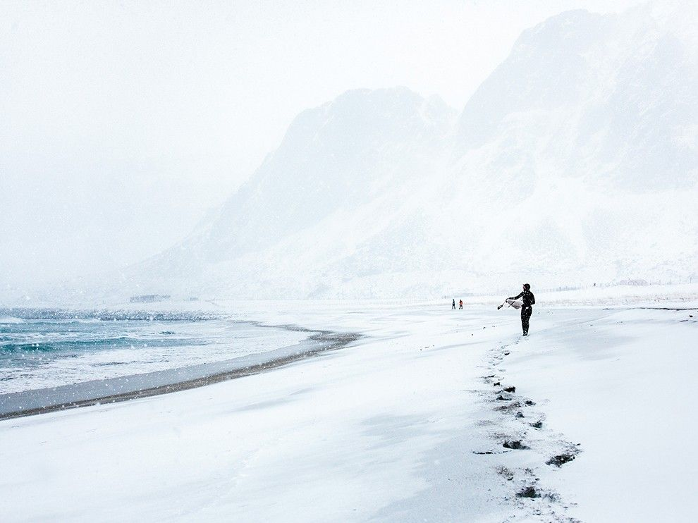 Surfers wait for the perfect Arctic swell on Unstad Beach in Norway's Lofoten Islands in this National Geographic Photo of the Day.