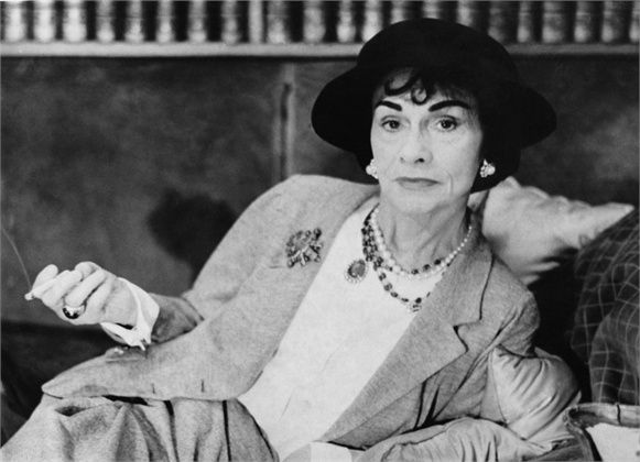 Coco Chanel 1962  She was born on August 19th, 1883, in a small village in the South of France; Coco started out in the fashion industry in 1908, creating hatsin Paris and later in Deauville. In the 10s, those cities plus Biarritz saw the opening of her first shops. During the Belle Epoque, women were constrained in rigid corsetsand wore pleated, draped and reinforced dresses with petticoats.