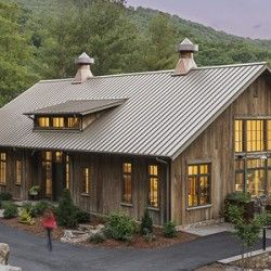 Heritage restorations barn home timber frame event for Houses built out of metal buildings