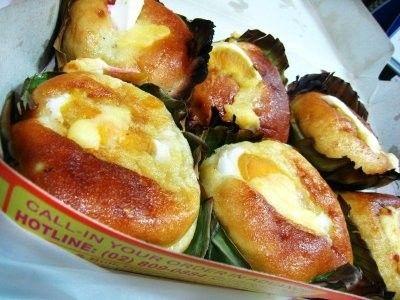 Bibingka: a baked rice cake wrapped in banana leaf ...