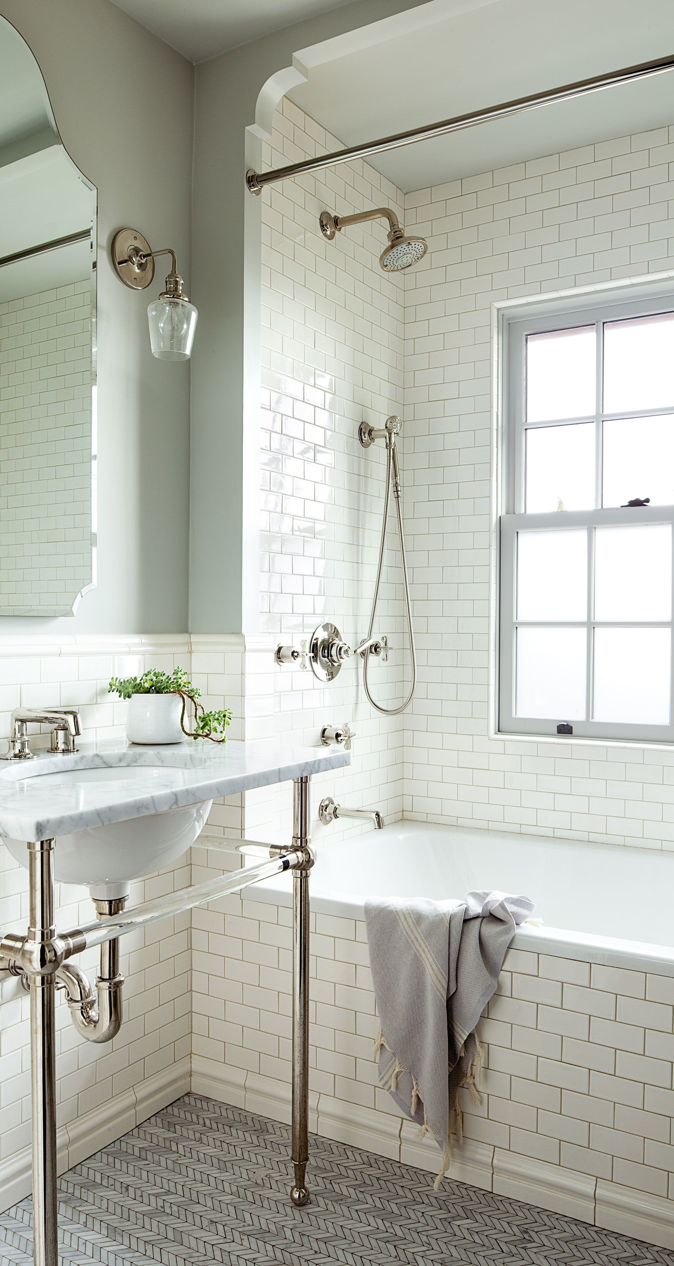 A 1920s House With A Modern Twist In Portland Oregon Small Bathroom Remodel Bathroom Remodel Master White Subway Tile Bathroom