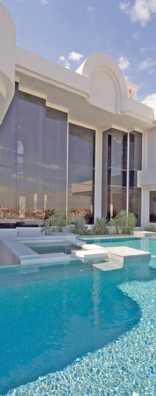You know how I love huge windows. Pool looks great. Very elegant yet simple exterior