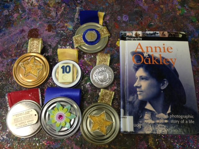 Marlena's (8yrs) Juice Can Lids are awesome recreations of Annie Oakley's medal of honors collection for a Great American's school project!