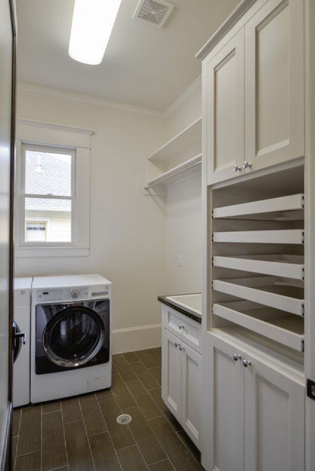 Comfortable Traditional Laundry Room With Sweater Drying Rack