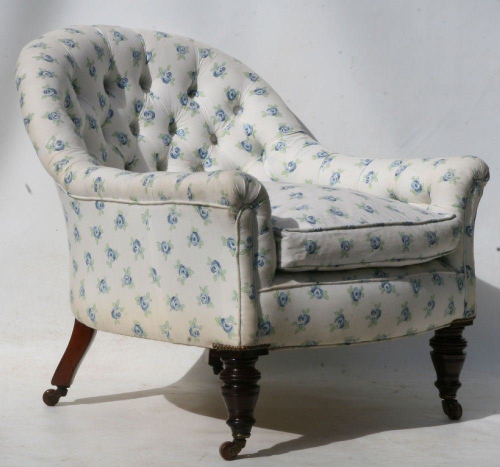 A LATE VICTORIAN TUB CHAIR UPHOLSTERED IN BUTTONED COTTON CHINTZ ...